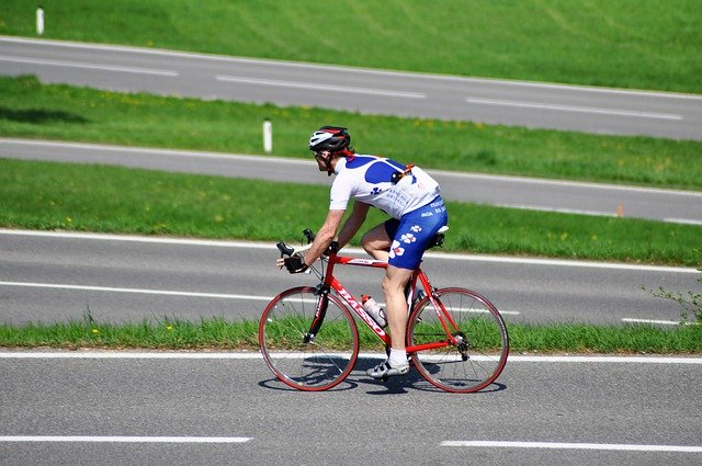 A man riding a bicycle on a road