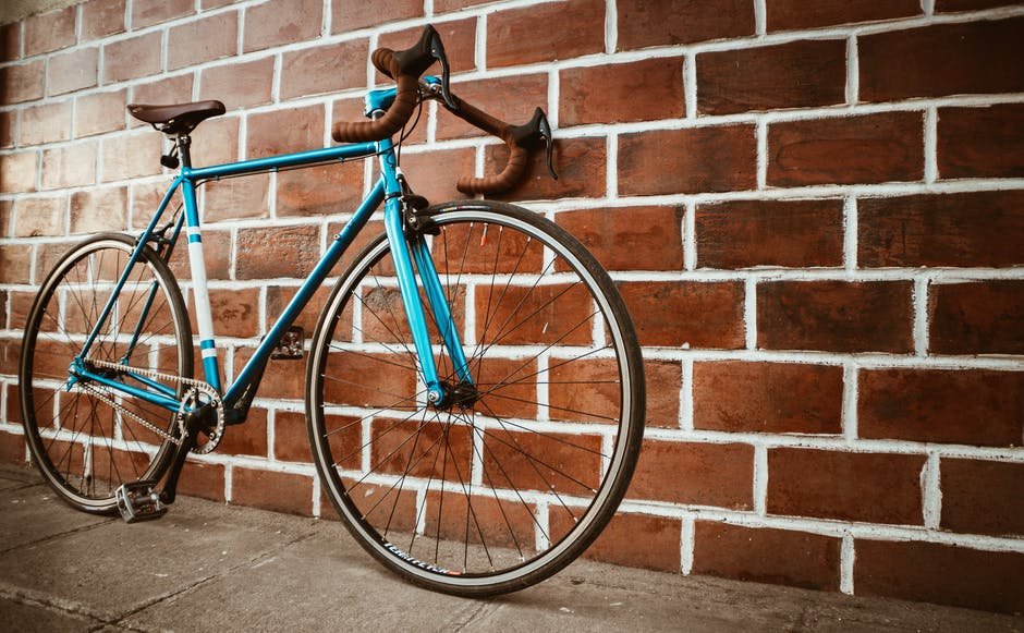 A bicycle parked in front of a brick building