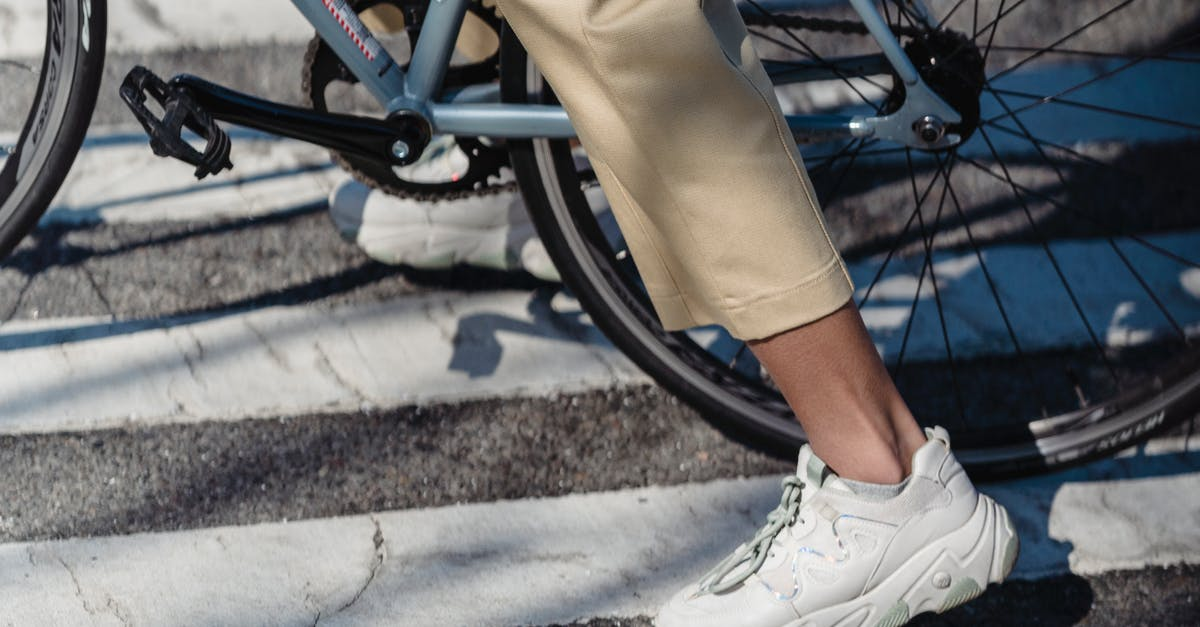 A person sitting on a bicycle
