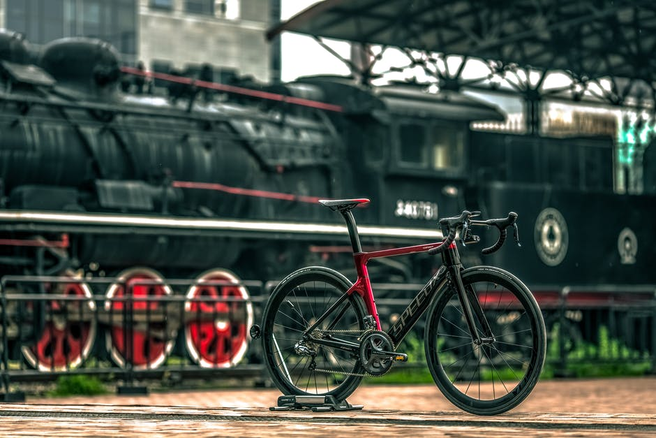 A train that is sitting on a bicycle